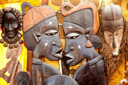African handcraft dark wood carved profile faces...