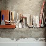 Construction mason cement mortar tools in a row...