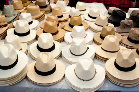 Beige and white straw hats in a row