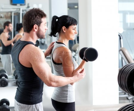 Photo for Gym woman personal trainer man with weight training equipment - Royalty Free Image