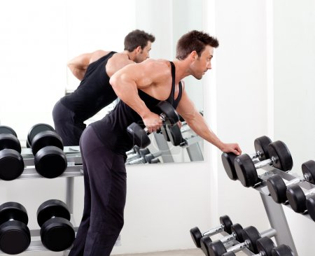 Photo for Man with weight training equipment on sport gym club - Royalty Free Image