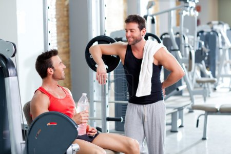 Two men on a sport gym relaxed after fitness