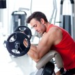 Man with weight training equipment on sport gym cl...