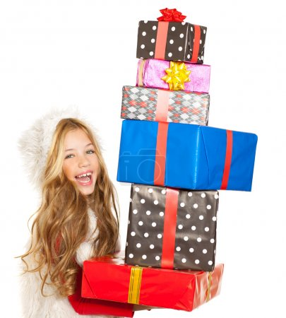 Kid little girl with christmas present gifts stacked