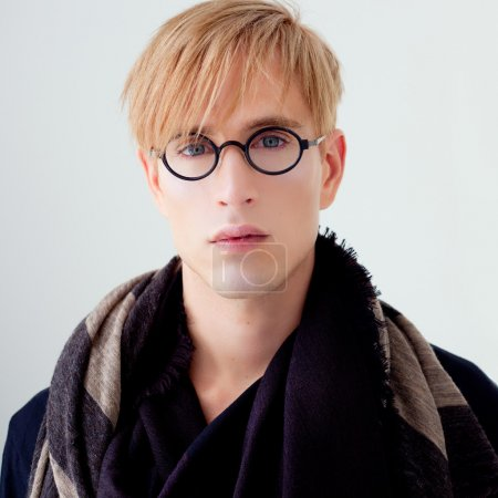 Blond modern student man with nerd glasses