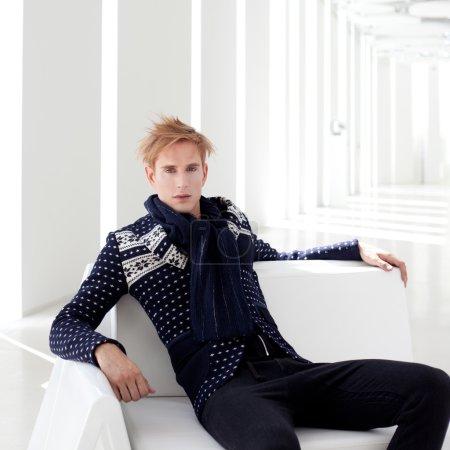 Modern blond male futuristic sci-fi sitting