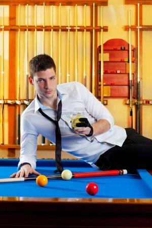 Billiard handsome player man drinking alcohol