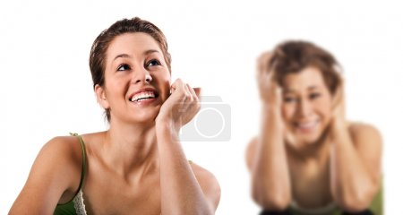 Contradiction - a happy smiling and a unhappy depressed woman