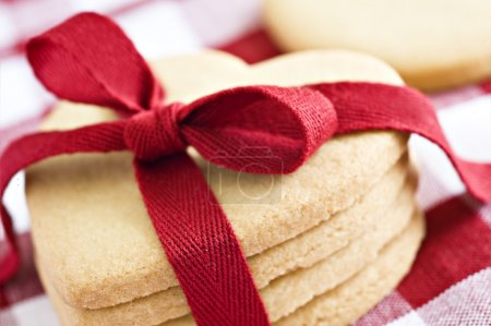 Photo for Heart shaped cookies with a red ribbon on a cloth - Royalty Free Image