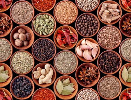 Seamless texture of spices on black