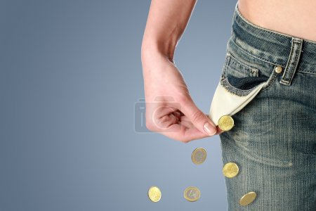 Photo for Financial crisis concept. Empty pocket and coins. - Royalty Free Image