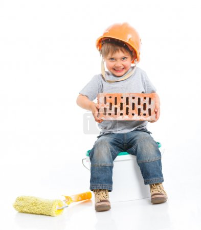 Photo for Boy in hard hat with brick. Isolated white backround - Royalty Free Image