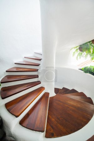Photo for White and wood spiral staircase in modern interior. Vertical view - Royalty Free Image