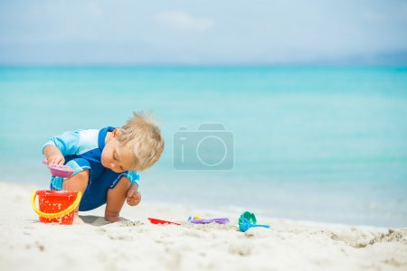 Photo for Cute baby boy playing with beach toys on tropical beach - Royalty Free Image