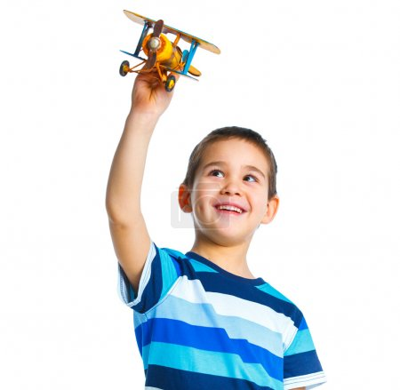 Photo for Cute little boy playing with a toy airplane. Isolated on white background - Royalty Free Image