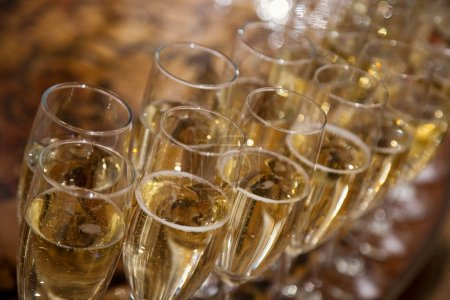 Photo for Lot of glasses with champagne during on the party table - Royalty Free Image