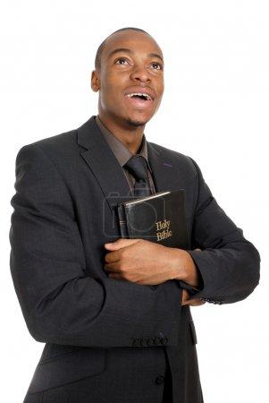 Photo pour C'est une image d'un homme tenant une bible montrant son engagement . - image libre de droit