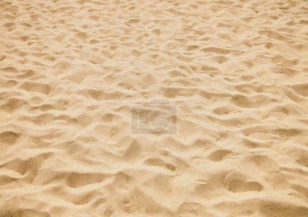 Photo pour Texture de sable jaune sur la plage - image libre de droit
