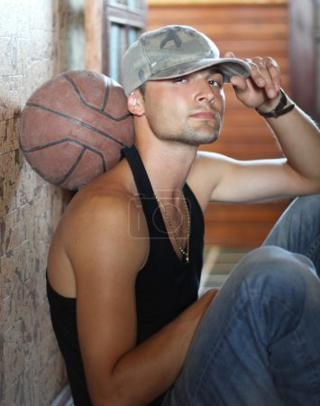 Basketball player recreation, sitting on floor