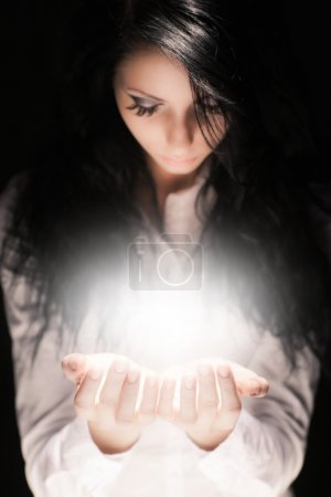 Brunette girl holding something special in her hands