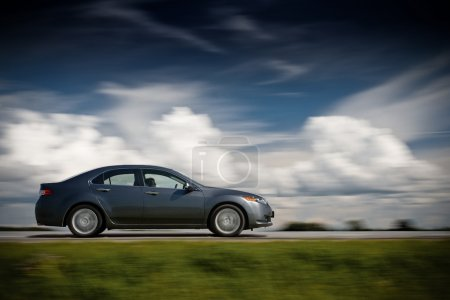 Photo for Car driving fast. Brutal colors. - Royalty Free Image