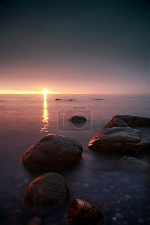 Photo for Beautiful sunset in a calm bay - Royalty Free Image