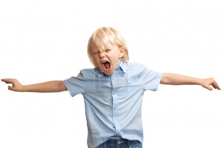 Photo for A loud and screaming young boy trying to get attention - Royalty Free Image