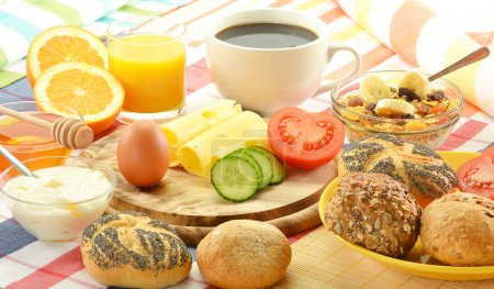 Photo for Breakfast including rolls, egg, cheese, coffee and orange juice on the table - Royalty Free Image