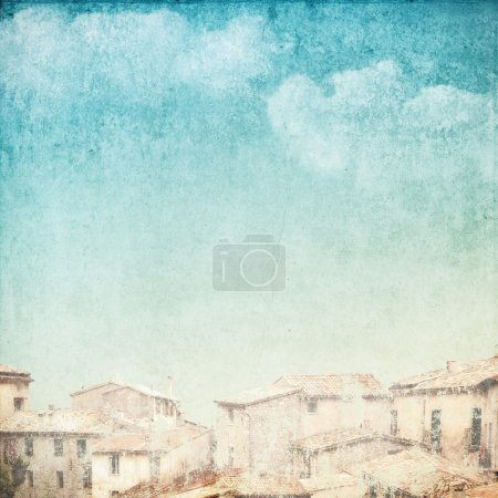 Photo for Vintage background with clouds and roofs - Royalty Free Image