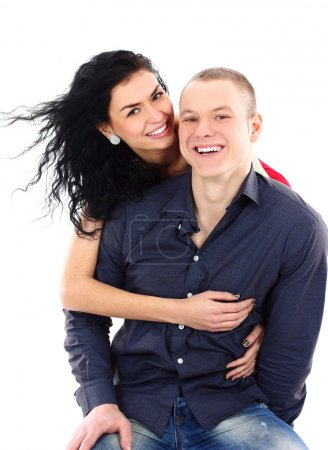 Portrait of a happy young couple having fun together against white