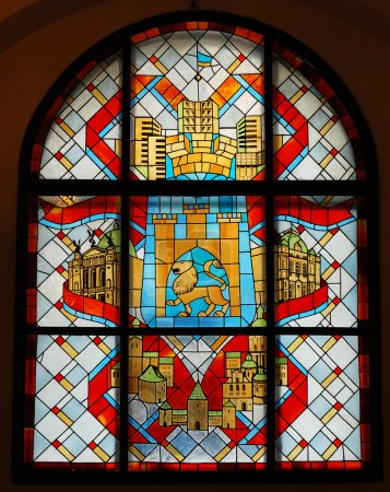 Stained glass window with emblem of the city in ancient castle