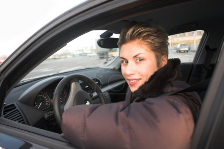 Photo for Woman driving a car hands on the wheel - Royalty Free Image