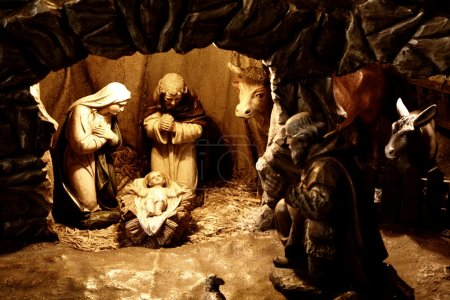 Photo for Nativity Scene. Made by wooden figures. Main characters are in the light spot. - Royalty Free Image