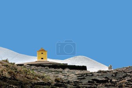 Old windmill in sunset, Yaiza, Lanzarote...