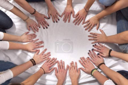 Photo for Hands of girls form a circle - Royalty Free Image