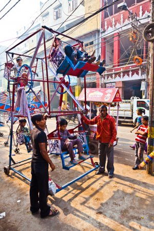Children have fun in a hand driven wheel