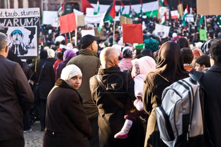 Photo for FRANKFURT, GERMANY - 3 JANUARY: 10000 demonstrate against the bombing of Gaza and for freedom in Palestine and a an own state for the palestines at the R - Royalty Free Image