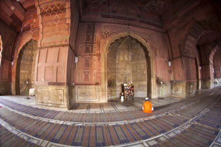 Man praying in the mosque Jama Masjid in Delhi