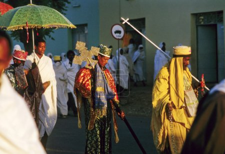 Priest carries the holy ark in a ceremony through the streets