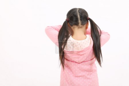 Photo for Crying standing little girl, back view - Royalty Free Image