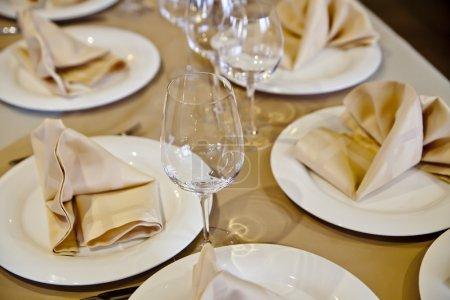 Wine glasses set at reataurant table