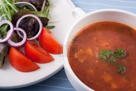 Photo for Minestrone soup and a side salad with greens onions and tomatoes for a great low calorie and nutritious lunch. - Royalty Free Image