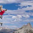 Rock climber struggles to reach his next grip on t...