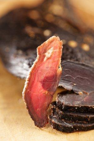 Biltong - dry cured beef meat , backlit slice