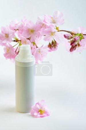 Face cream with sakura flowers