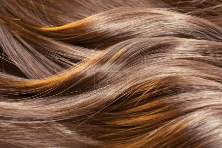 Photo for Beautiful healthy shiny hair texture with highlighted golden streaks - Royalty Free Image