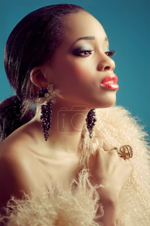 Beautiful young black woman with dark eye makeup and red lips
