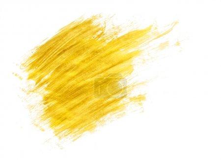 Photo for Gold acrylic paint brush strokes on white background - Royalty Free Image