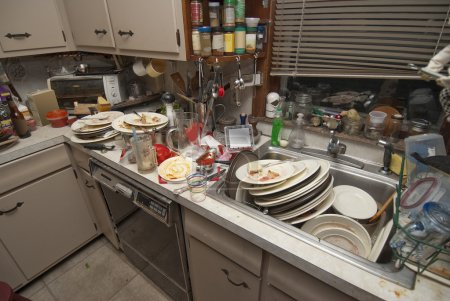 Photo for Dirty dishes piled up in sink after a party - Royalty Free Image
