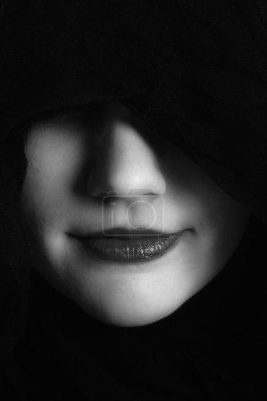 Woman in black hood